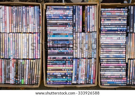 ELGIN, SCOTLAND - OCTOBER 8 2015: Large selection of pre-owned DVDs at a charity shop in Elgin. - stock photo