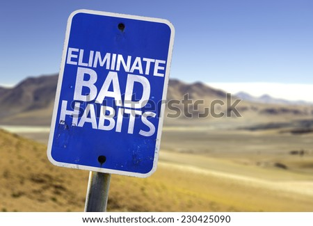 Eliminate Bad Habits sign with a desert background - stock photo