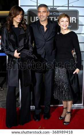 """Elisabetta Canalis, George Clooney and his mother Nina at the Los Angeles Premiere of """"Up In The Air"""" held at the Man Village Theater in Westwood, USA on November 30, 2009. - stock photo"""