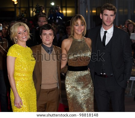 Elizabeth Banks, Josh Hutcherson, Jennifer Lawrence and Liam Hemsworth arriving at The Hunger Games Premiere, at the 02 Arena, London. 14/03/2012 Picture by: Simon Burchell / Featureflash - stock photo