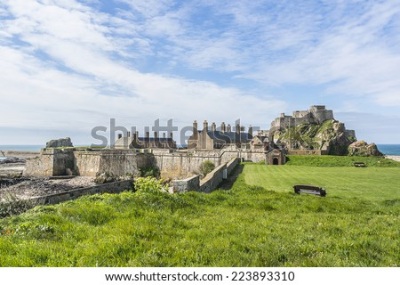 Elizabeth Castle (1594) - castle & tourist attraction on a tidal island within parish of Saint Helier, Jersey, UK. It is named after Elizabeth I who was queen of England at time when castle was built.
