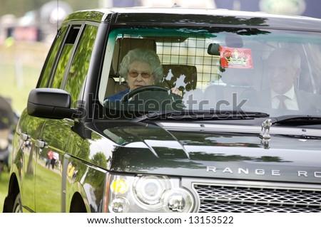 Elizabeth II driving her car - stock photo
