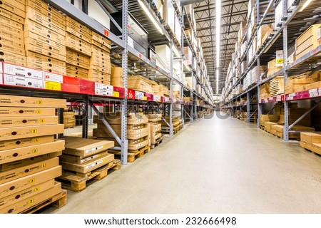 ELIZABETH, NJ, USA - NOVEMBER 23, 2014: Warehouse aisle in an IKEA store. Founded in 1943, IKEA is the world's largest furniture retailer. IKEA operates 351 stores in 43 countries. - stock photo