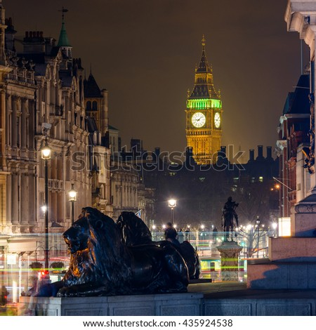 Elizabeth Tower also known as the Clock Tower seen from Trafalgar Square at night in London, England, UK - stock photo