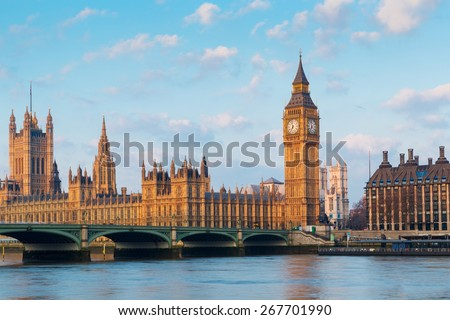 Elizabeth Tower, Big Ben and Westminster Bridge in early morning light, London, England, UK - stock photo