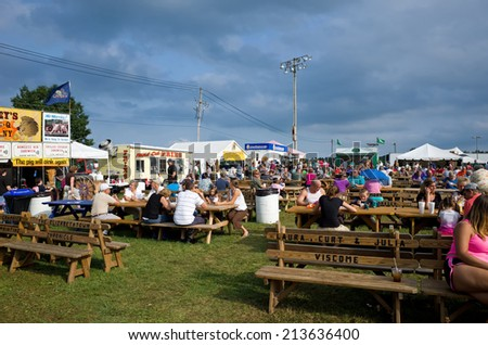 ELIZABETHTOWN, PA, USA-AUGUST 22, 2014:  Carnivals and country fairs are in full swing. They are common in late summer and early fall and include exhibits, food, rides, and entertainment for all ages. - stock photo