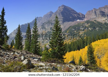 Elk Mountains of Colorado with golden and green aspen during foliage - stock photo