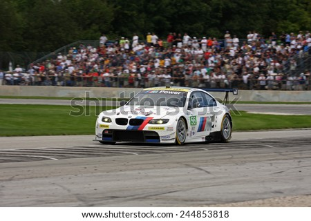 Elkhart Lake Wisconsin, USA - August 18, 2012: Road America Road Race Showcase, ALMS, multi-class sports car and GT motor race. American Le Mans Series IMSA. Joey Hand, Jonathan Summerton, BMW M3   - stock photo