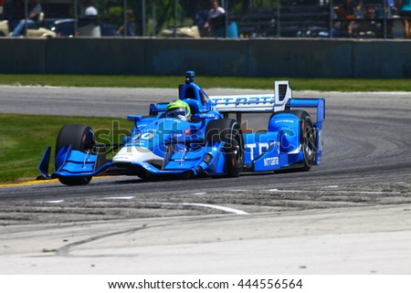 Elkhart Lake Wisconsin USA - 24 June 2016: Indycar racing action Road America. Practice session Tony Kanaan, Chevrolet