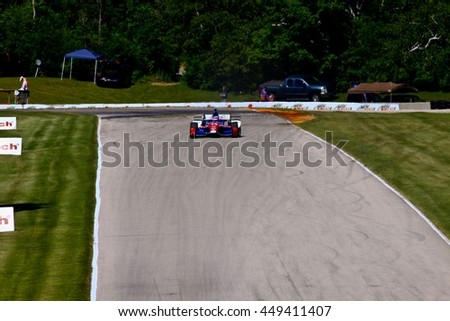 Elkhart Lake Wisconsin USA - 24 June 2016: Indycar racing action Road America. Practice session driver Takuma Sato #14, A.J. Foyt Enterprises, ABC Supply