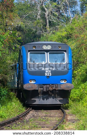 ELLA, SRI LANKA - MARCH 2, 2014: Train on railway in forest. Trains go to Colombo and Kandy from Ella. - stock photo