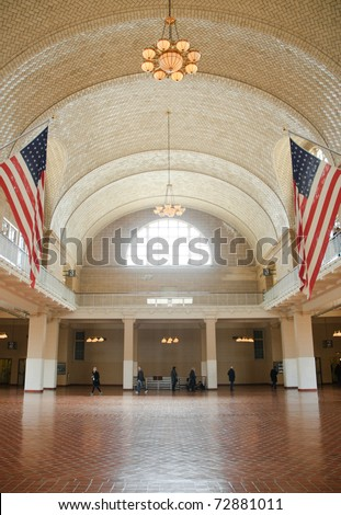 Ellis Island National Monument interior and American Flags - stock photo