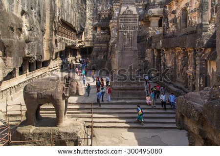 ELLORA, INDIA - 14 JANUARY 2015: North side of Kailasa temple part of Ellora Caves. Also known as Kailasanatha temple one of biggest rock-cut ancient Hindu temples. - stock photo