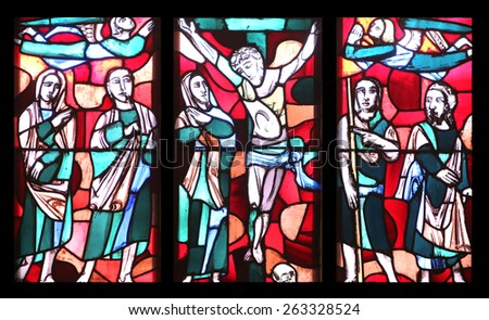 ELLWANGEN, GERMANY - MAY 07: Crucifixion, stained glass window in Basilica of St. Vitus in Ellwangen, Germany on May 07, 2014. - stock photo