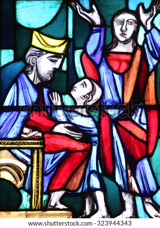 ELLWANGEN, GERMANY - MAY 07: Hannah presenting her son Samuel to the priest Eli, Stained glass window in Basilica of St. Vitus in Ellwangen, Germany on May 07, 2014.