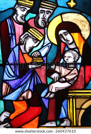 ELLWANGEN, GERMANY - MAY 07: Nativity Scene, Adoration of the Magi, stained glass window in Basilica of St. Vitus in Ellwangen, Germany on May 07, 2014. - stock photo