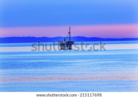 Ellwood Oil Well Offshore Platforms Coastline Pacific Ocean Pink Sunset Goleta California - stock photo