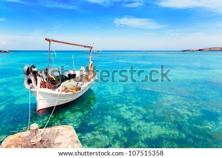 Els Pujols beach in Formentera with traditional fishing boat in summer day - stock photo