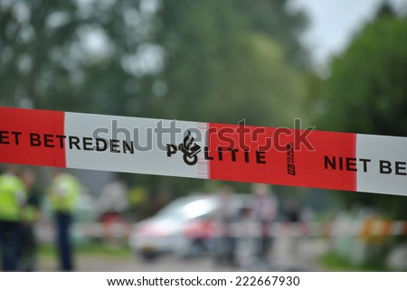 ELSPEET, THE NETHERLANDS, CIRCA SEPTEMBER 2014 - Dutch police officers investigating a crash site after an accident. - stock photo