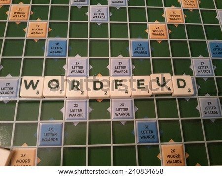 Elspeet,  The Netherlands, 31 December 2014 - Scrabble game board with the word mark Wordfeud. - stock photo