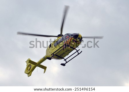 ELSPEET, THE NETHERLANDS, 10 February 2015 - Dutch ambulance helicopter in the sky - stock photo