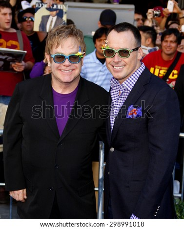 Elton John and David Furnish at the Los Angeles premiere of 'Gnomeo And Juliet' held at the El Capitan Theatre in Hollywood on January 23, 2011.  - stock photo