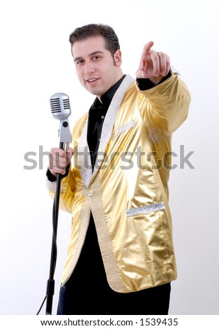 Elvis Impersonator Pointing at his Audience - stock photo