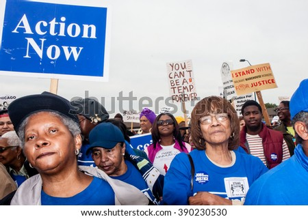 ELWOOD, ILLINOIS - OCTOBER 1, 2012: Striking workers and supporting activist groups march for better wages and working conditions at the Walmart distribution center. - stock photo