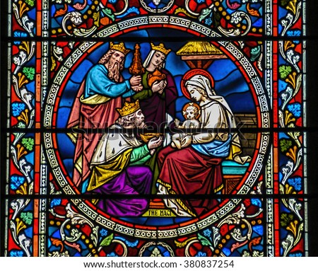 Ely, Ely Cathedral, United Kingdom, 5 June 2012, Stained glass window depicting biblical Christmas scene, the birth of Jesus Christ, with Mary and the three wise men (Magi) - stock photo