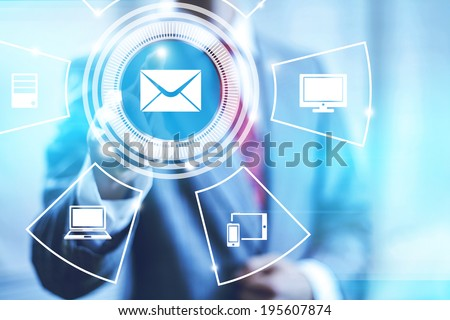 Email concept pointing finger selecting mail icon - stock photo