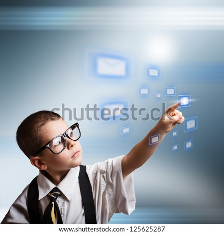 Email concept with little business boy dressed in oversized suit clothes