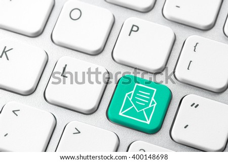 Email & contact us icon on computer keyboard
