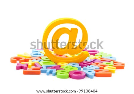 Email symbol and colorful letters on white background - stock photo