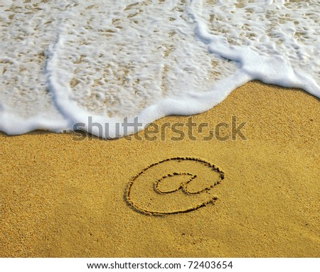 Email symbol draw on beach - stock photo