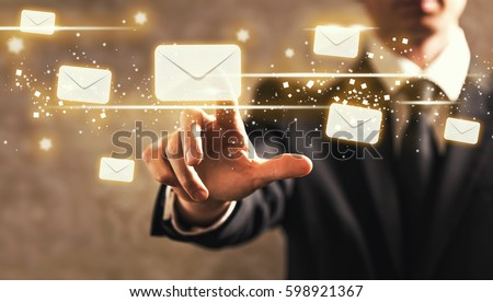 Emails with businessman on dark vintage background