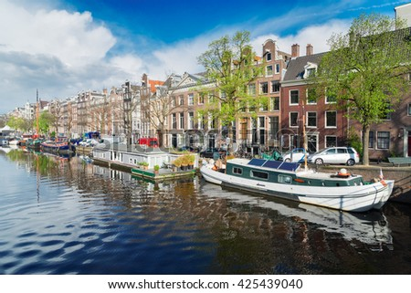 embankment of Amstel canal in Amsterdam at summer day, Netherlands - stock photo
