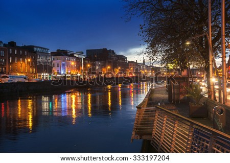 Embankment of Liffey River in Dublin, Ireland. Night view with buildings and city lights at the background - stock photo