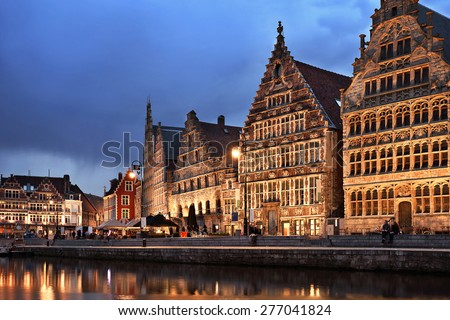 Embankment of old town at blue night, Graslei harbor, Leie river, Ghent, Belgium - stock photo