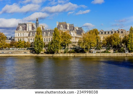 Embankment of Seine River and Hotel-de-Ville (City Hall, 1874 -1882, architects Theodore Ballou and Edouard Deperta) in Paris - building housing City of Paris's administration. France. - stock photo