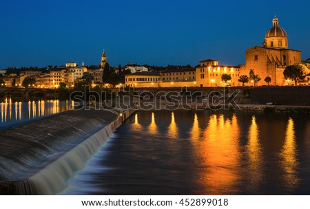 Embankment of the river Arno in Florence at night - stock photo