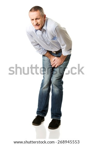 Embarassed man covering his painful crotch