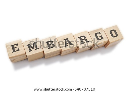 EMBARGO word made with building blocks isolated on white
