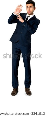 Embarrassed Caucasian man with short dark brown hair in business formal outfit defending with body - Isolated