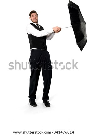 Embarrassed Caucasian man with short dark brown hair in business formal outfit holding umbrella - Isolated - stock photo