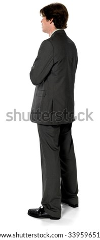 Embarrassed Caucasian man with short dark brown hair in business formal outfit with arms folded - Isolated