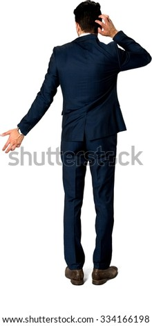 Embarrassed Caucasian man with short dark brown hair in business formal outfit with hands behind head - Isolated