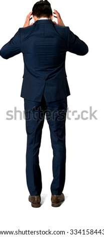 Embarrassed Caucasian man with short dark brown hair in business formal outfit with hands on head - Isolated
