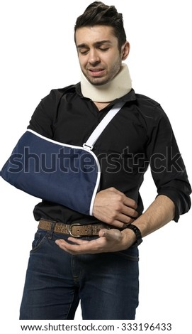 Embarrassed Caucasian man with short dark brown hair in casual outfit using neck brace - Isolated