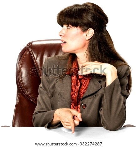 Embarrassed Caucasian woman with long dark brown hair in business formal outfit pointing using finger - Isolated