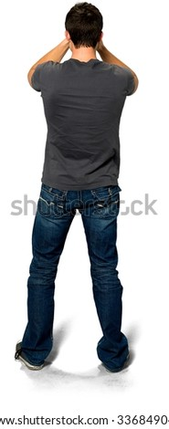 Embarrassed Caucasian young man with short black hair in casual outfit with hands on face - Isolated